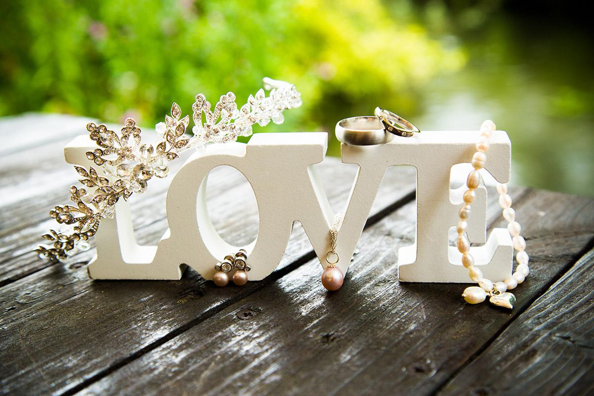 Love sign displaying wedding rings, tiara and jewellery
