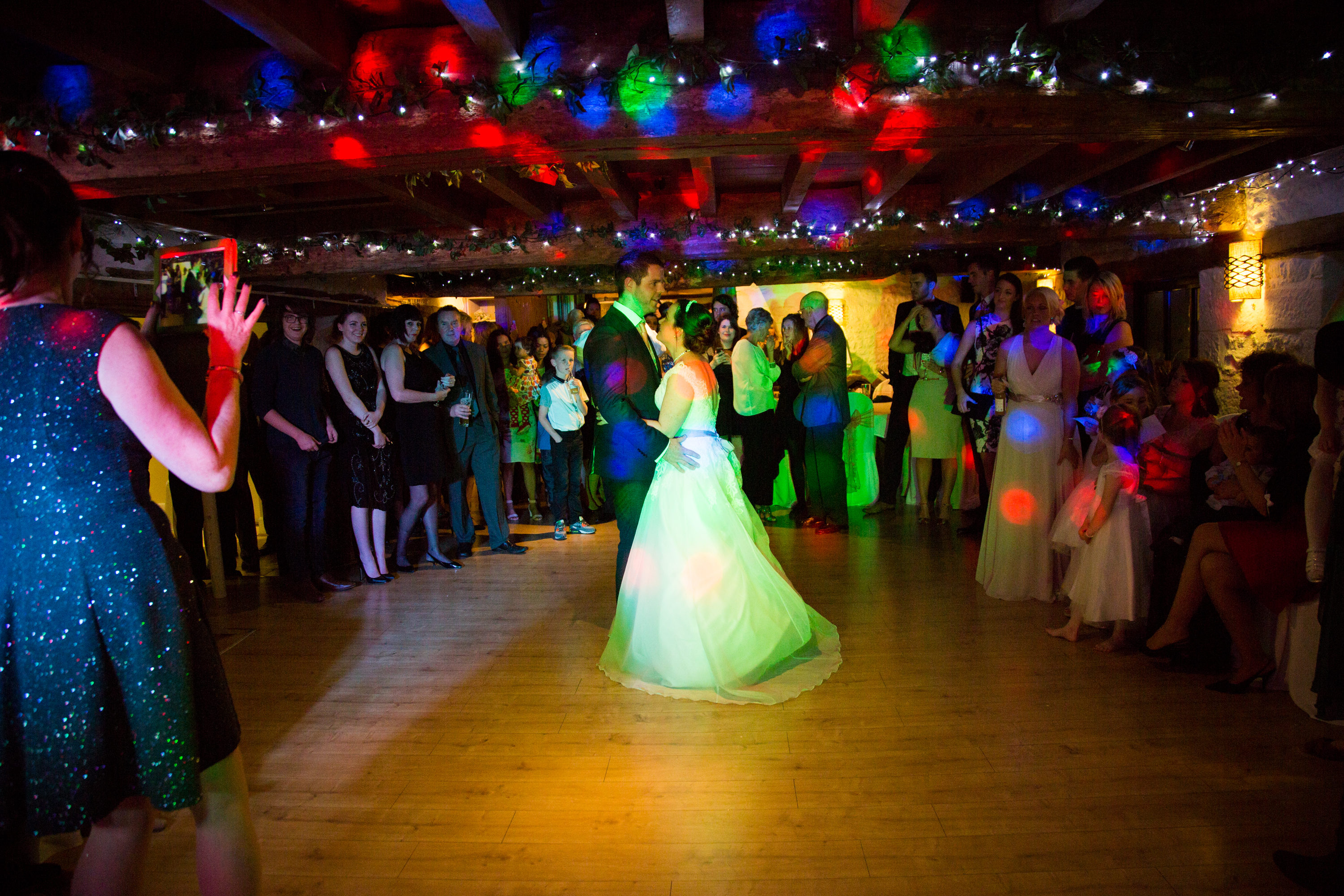 Bride and groom in the middle of the dance floor, dancing their first dance.