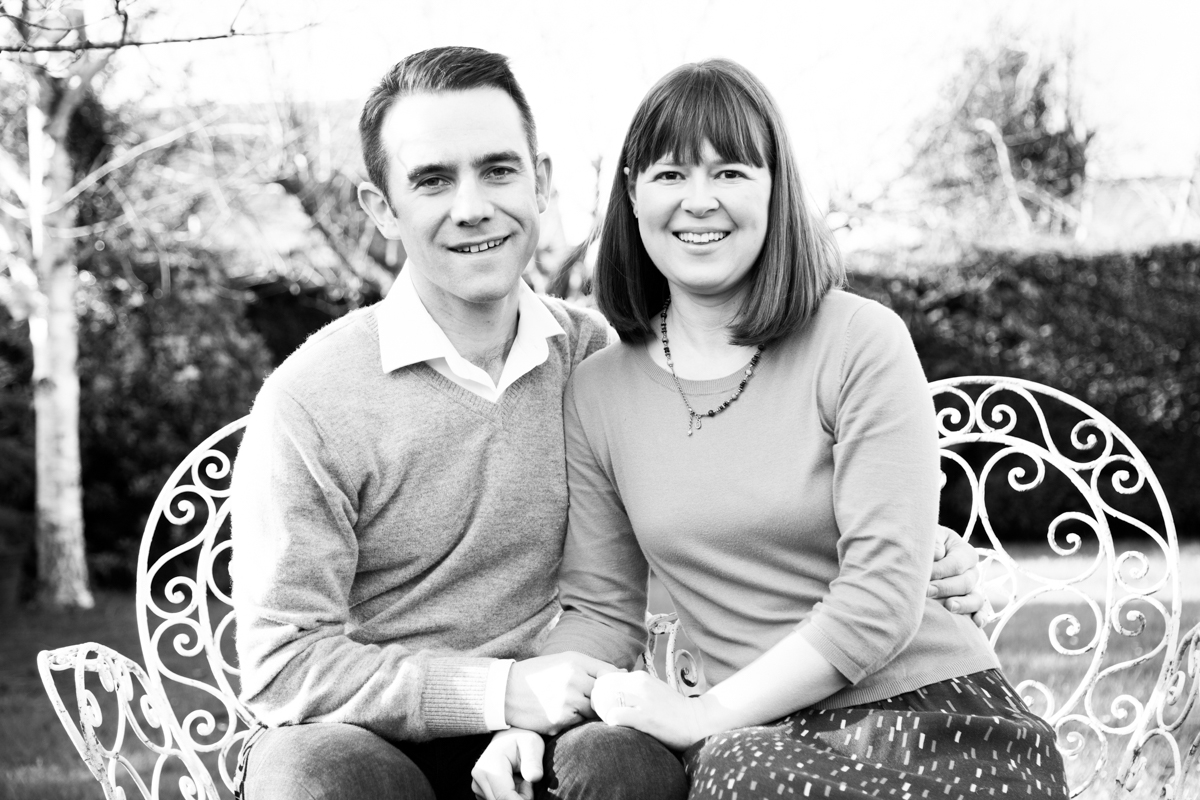 Married couple sat in the Ivy cottage garden in Bredon's Norton.