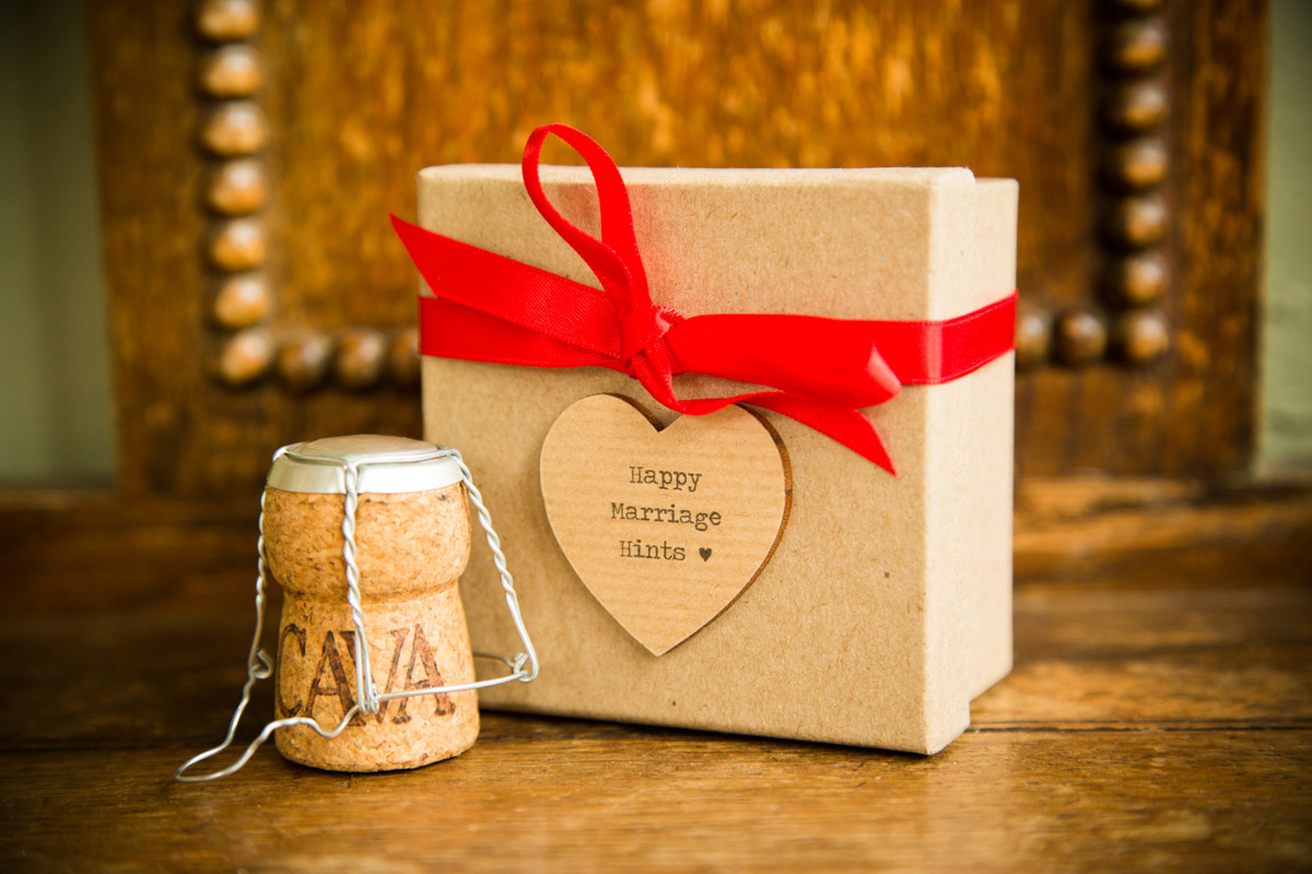 Happy wedding hints box with a champaign cork.