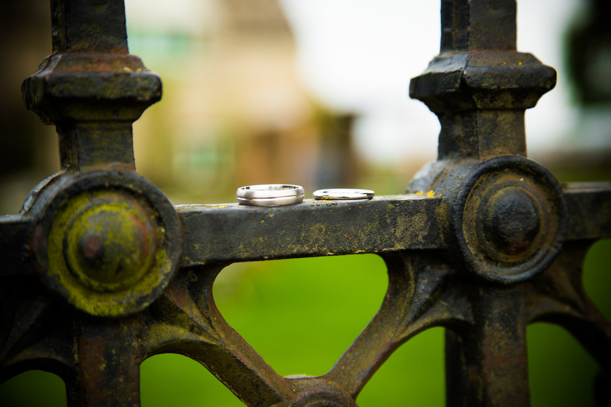 The wedding rings sat on black iron gate.
