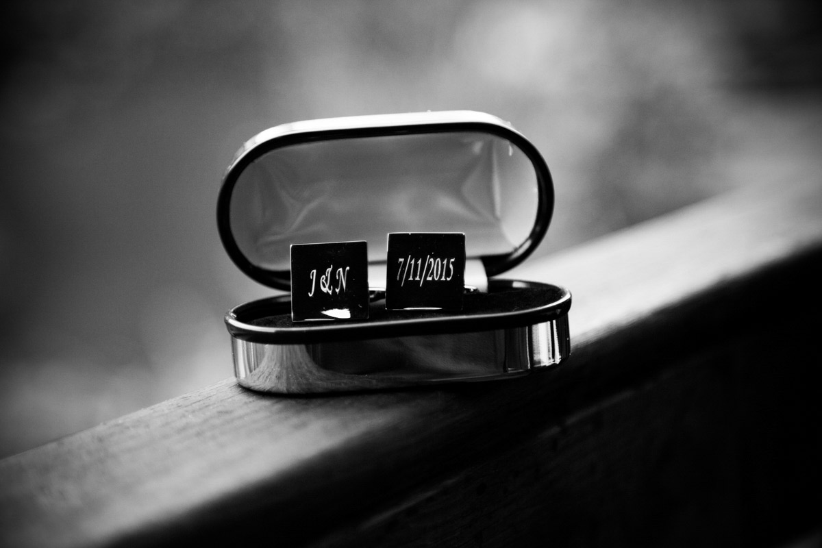 The grooms wedding cufflinks engraved with their wedding date.