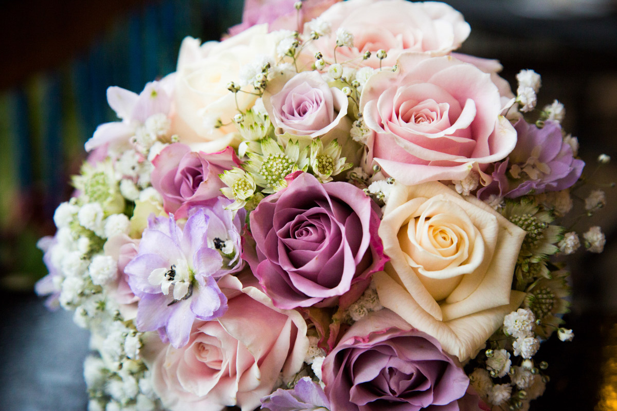 The brides wedding bouquet with pink and purple roses.