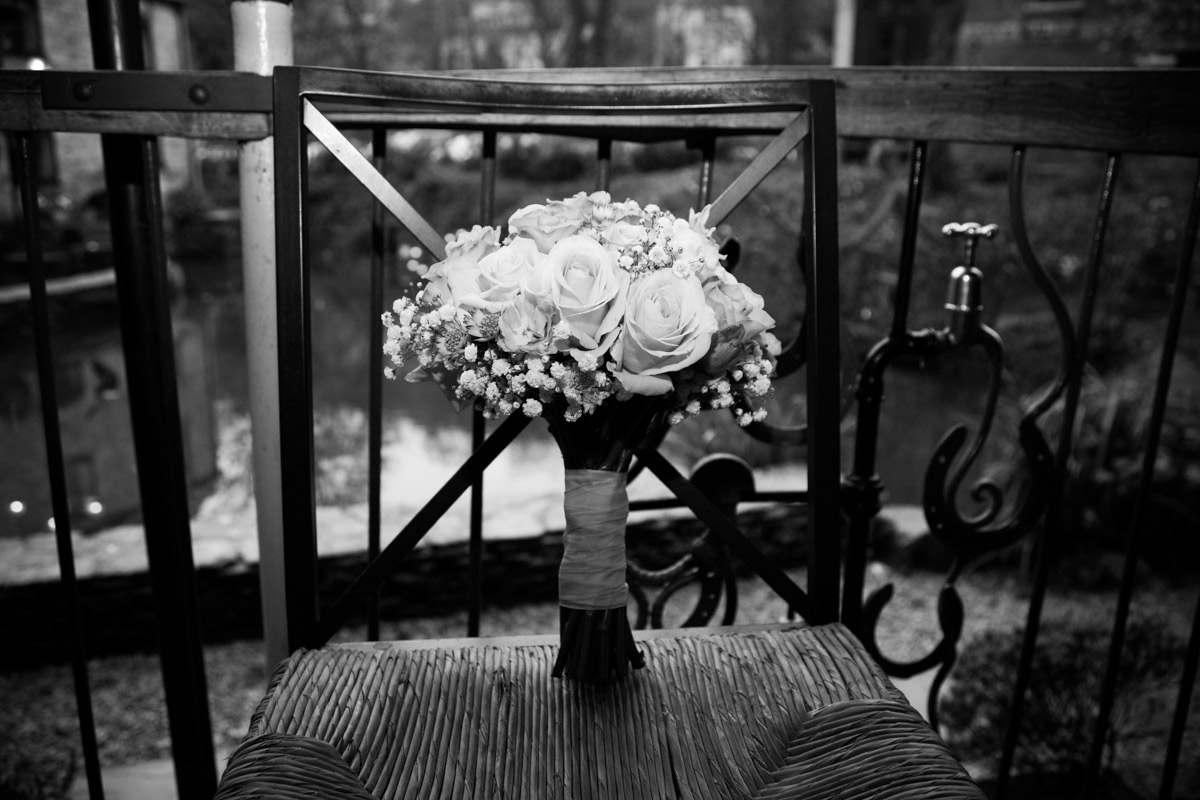 A wedding bouquet placed on a chair in the Egypt Mill Iron Works.