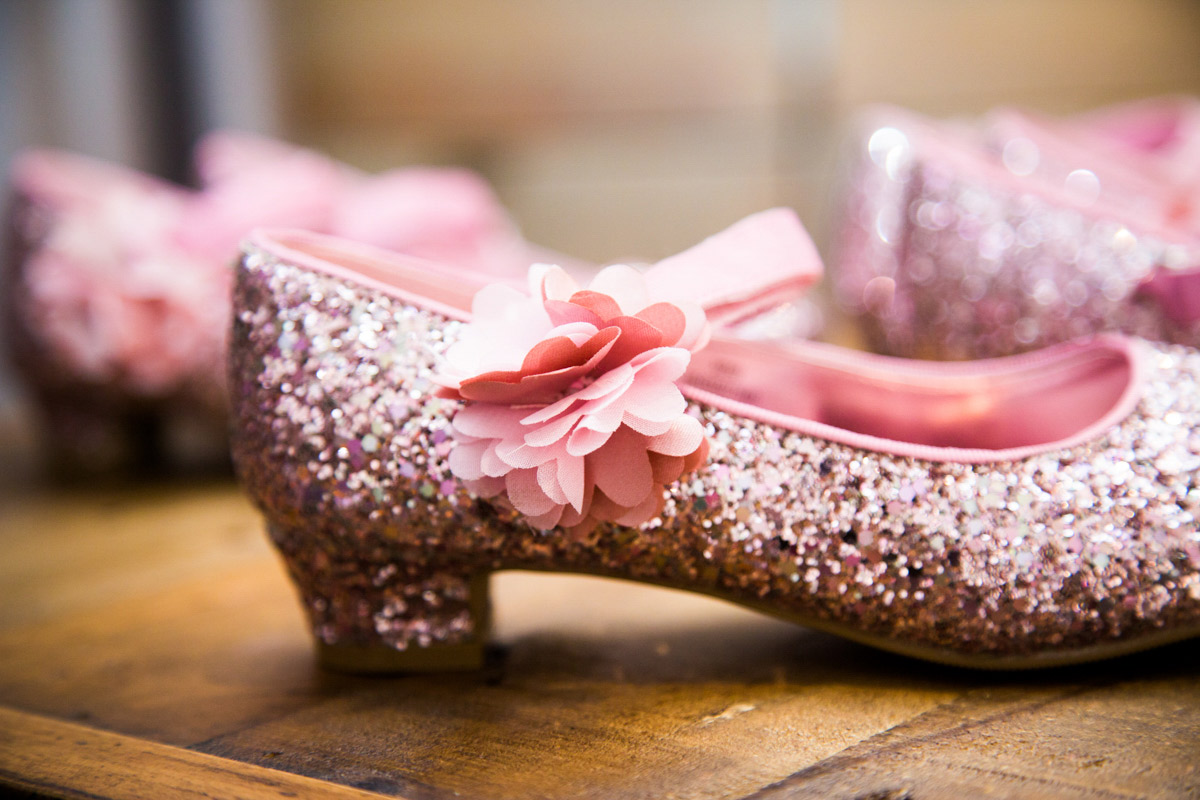 Pink glittery flower girl shoes.