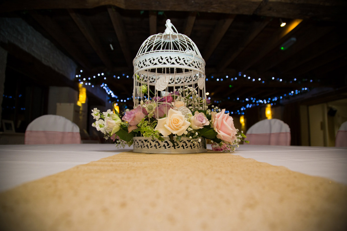 Birdcage and flower wedding centre piece at the Egypt Mill.
