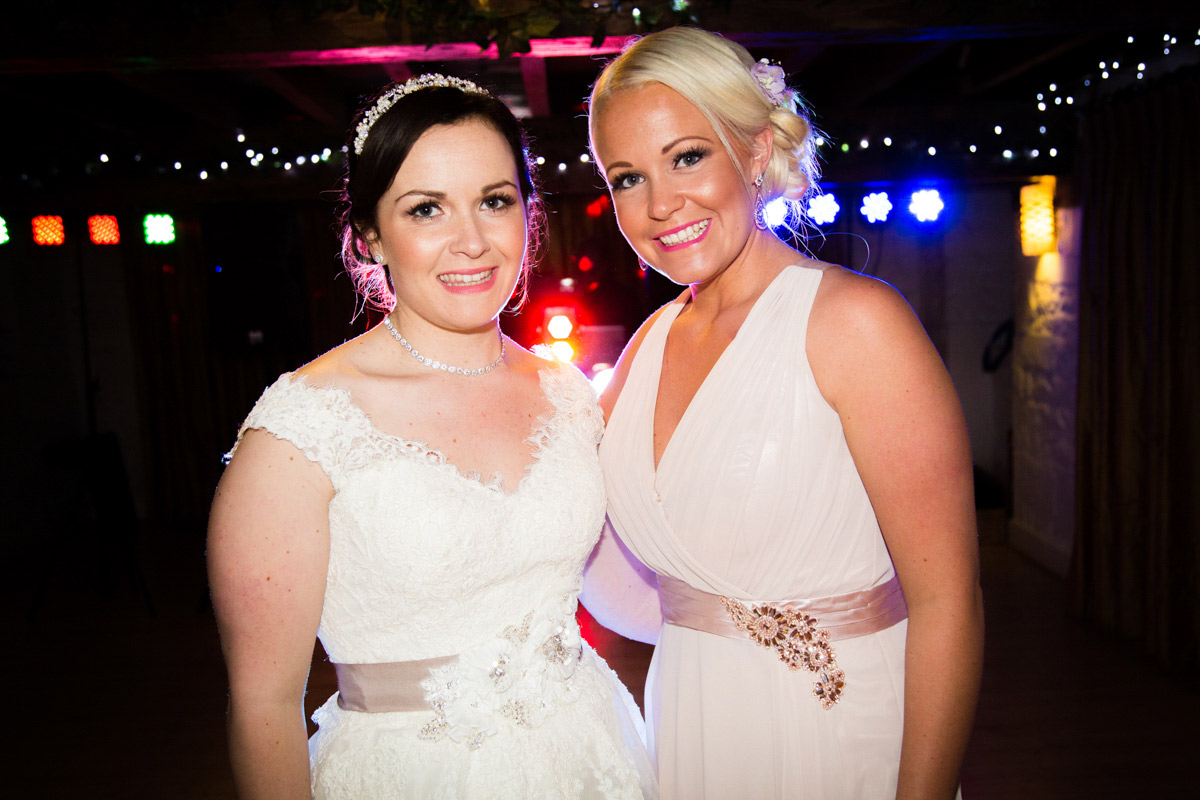 Bride and bridesmaid stood on the dance floor at The Egypt Mill.