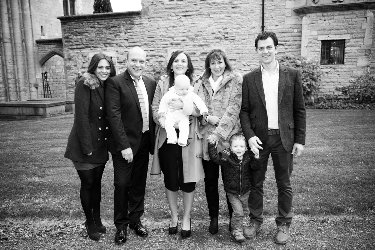 Godparents stood in a line outside the Tewkesbury abbey on Christening day.