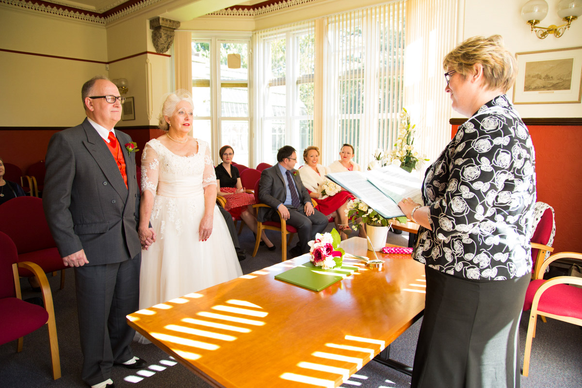 A bride and groom stood hand in hand at the Glasgow registry office.