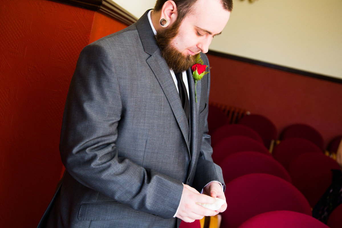 Best man bringing the rings forward in the Glasgow registry office.