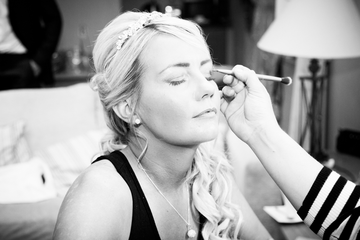 A bride having her wedding makeup done at The Feathers Hotel in Ledbury.
