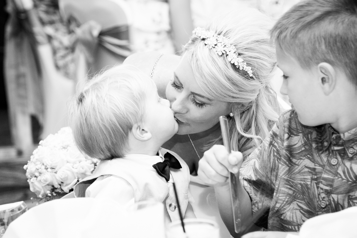 The bride giving a little boy a kiss at Puckrup Hall.
