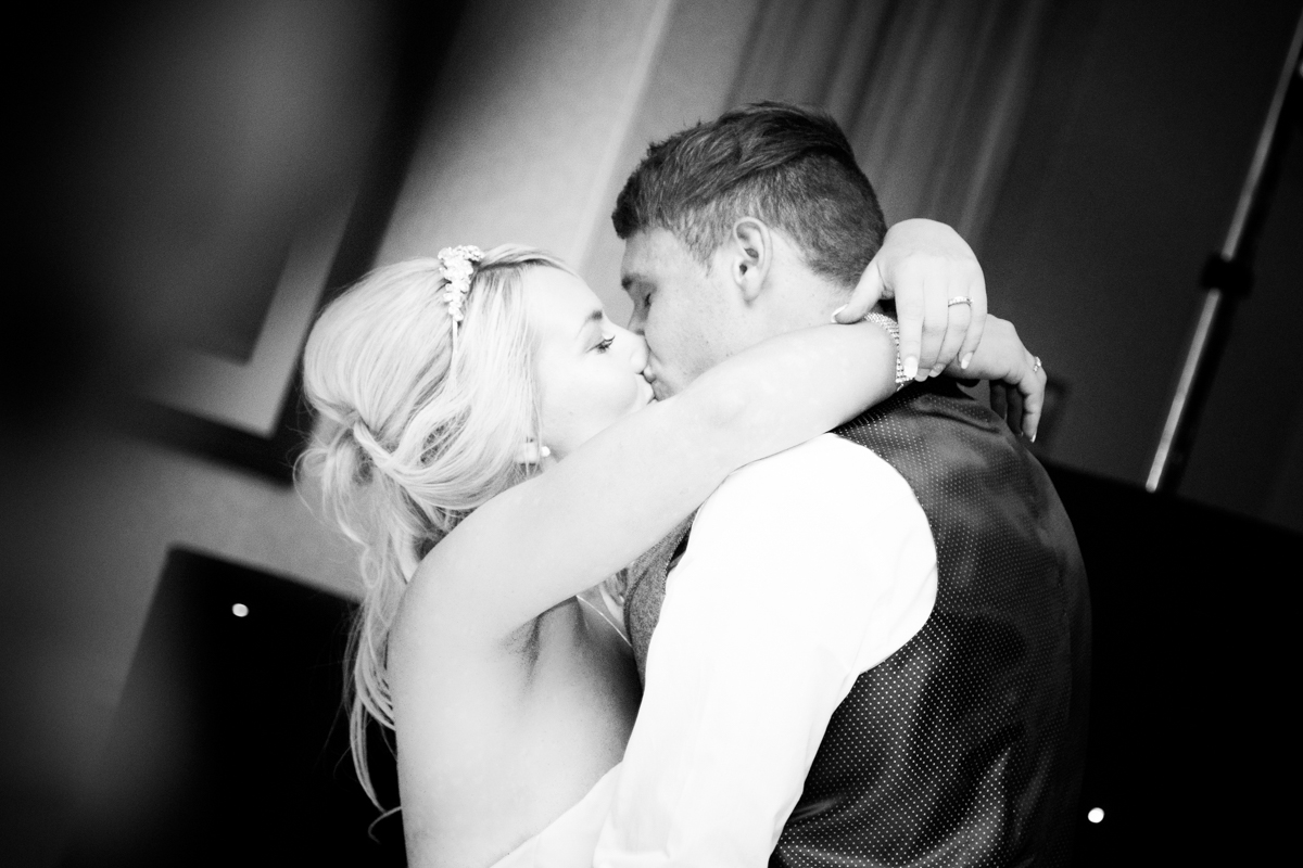 Newly weds kissing during their first dance at Puckrup Hall.