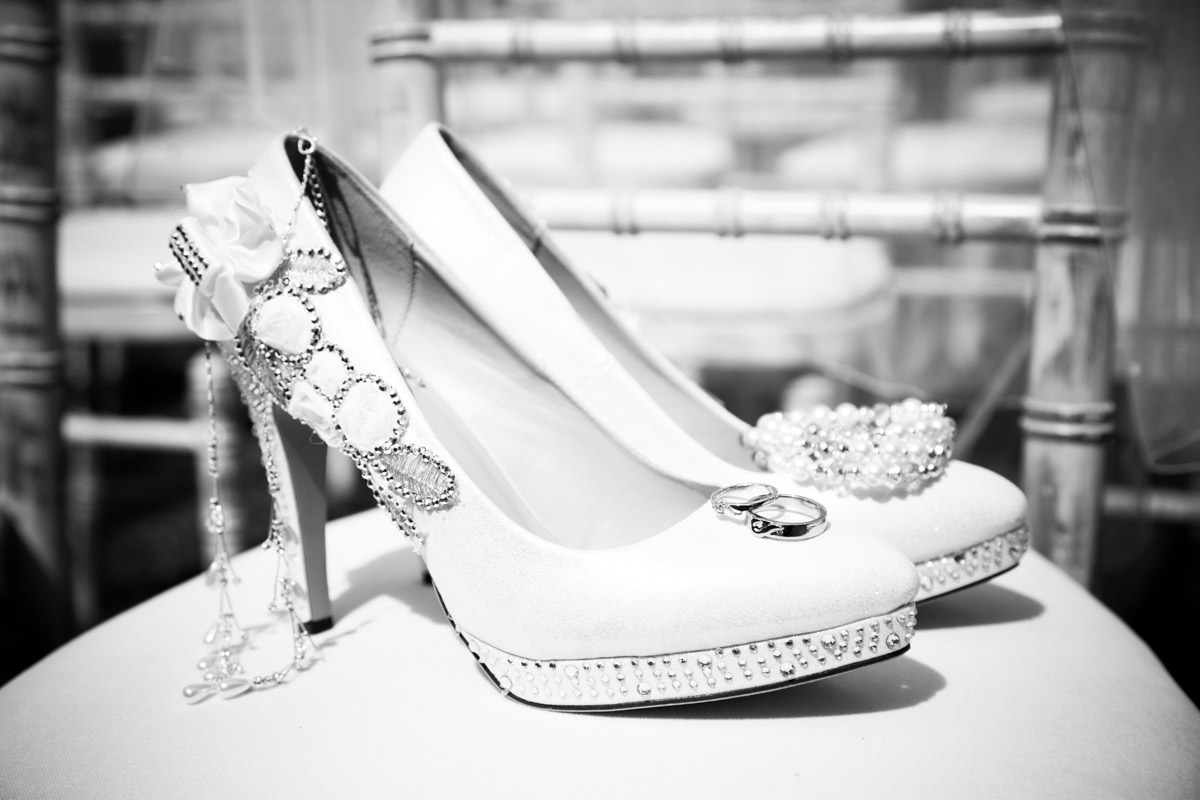 Brides wedding shoes holding her wedding jewellery.
