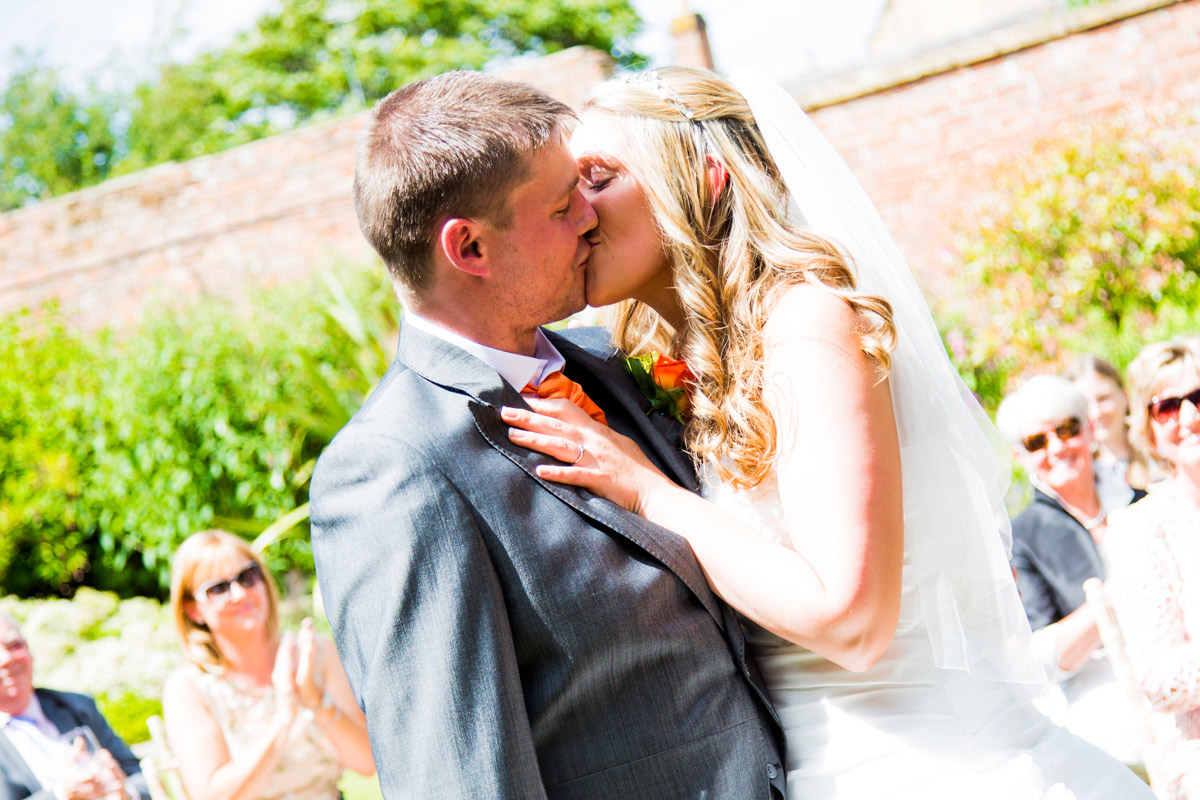 Bride and groom kissing at their moreton-in-marsh wedding