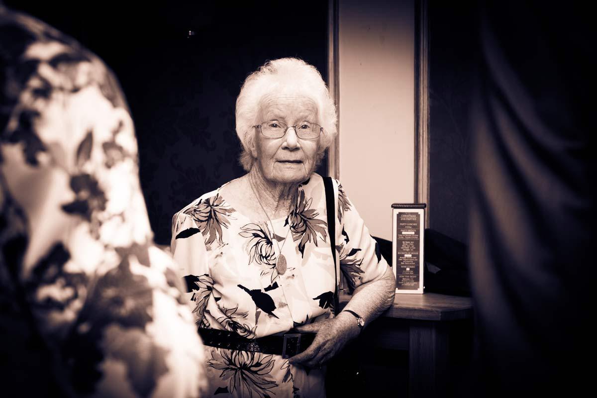 Grandma of the bride or groom wearing a floral dress.
