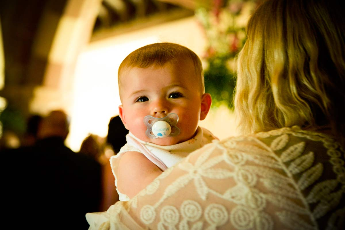 Baby during a wedding service in Berrow, Worcestershire.