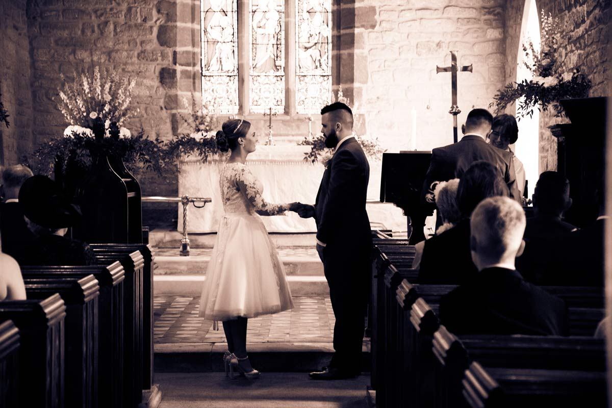 Bride and groom getting married at St Faith's Church, Berrow, Worcestershire.