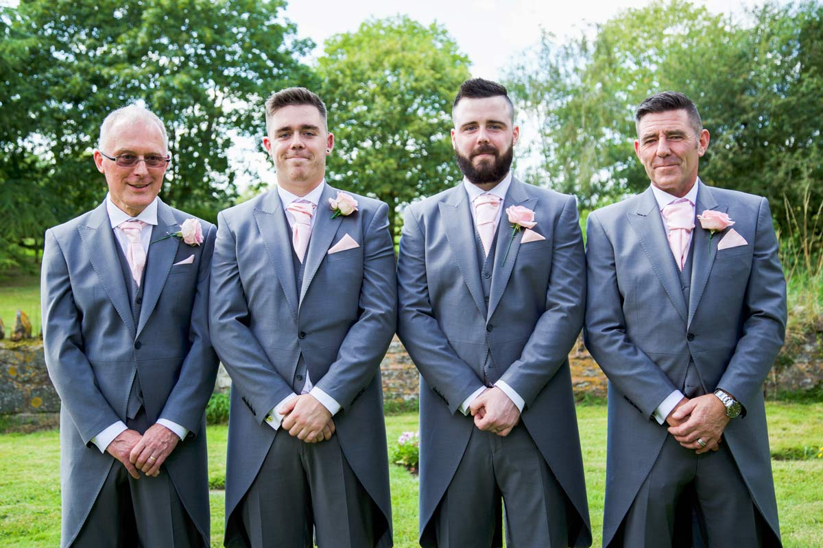 Groom stood with his best man, father and father in law at Berrow Church.