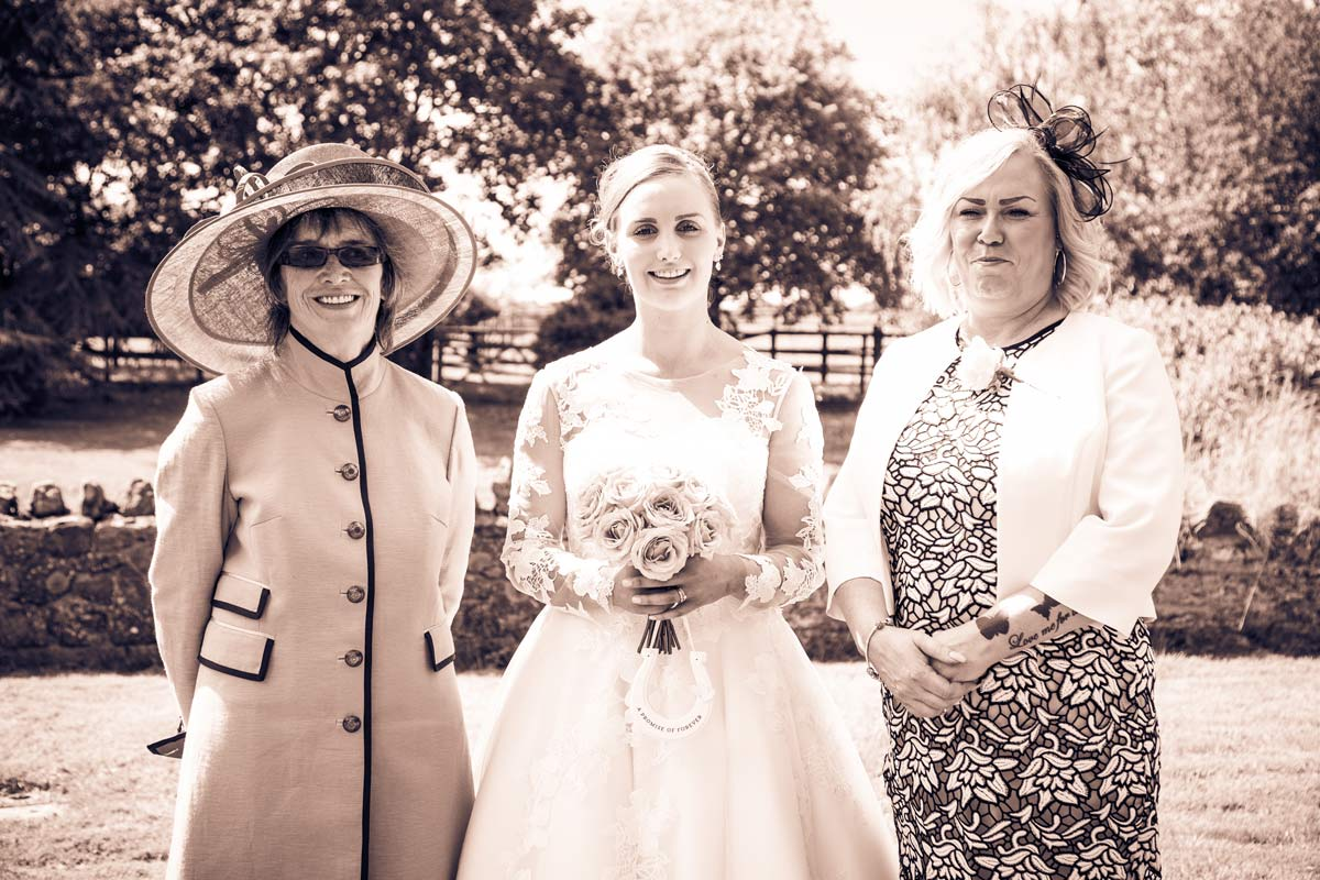 Bride with her mother and mother in law at St Faith's Church, Berrow.