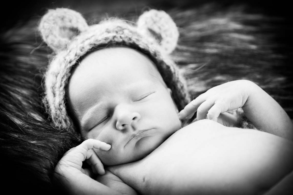 Newborn in bear bonnet in newborn shoot in cheltenham.