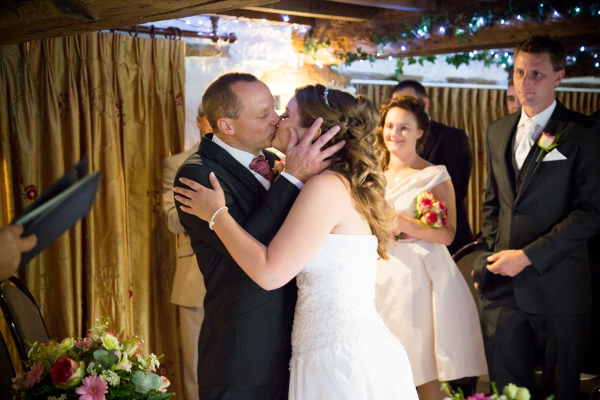 Bride and grooms first kiss during their wedding ceremony at the Egypt Mill.