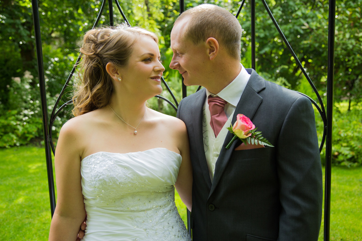 Bride and groom in the garden of the Egypt Mill.