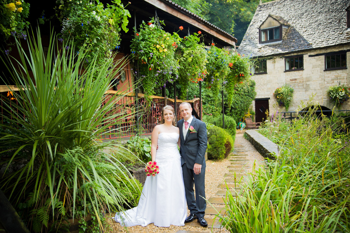 Bride and groom posing outside for their egypt mill wedding