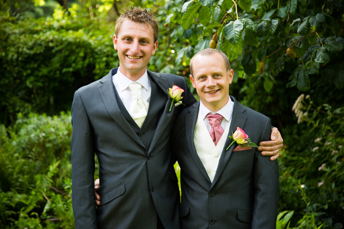 The groom and the best man in the garden of the Egypt Mill.