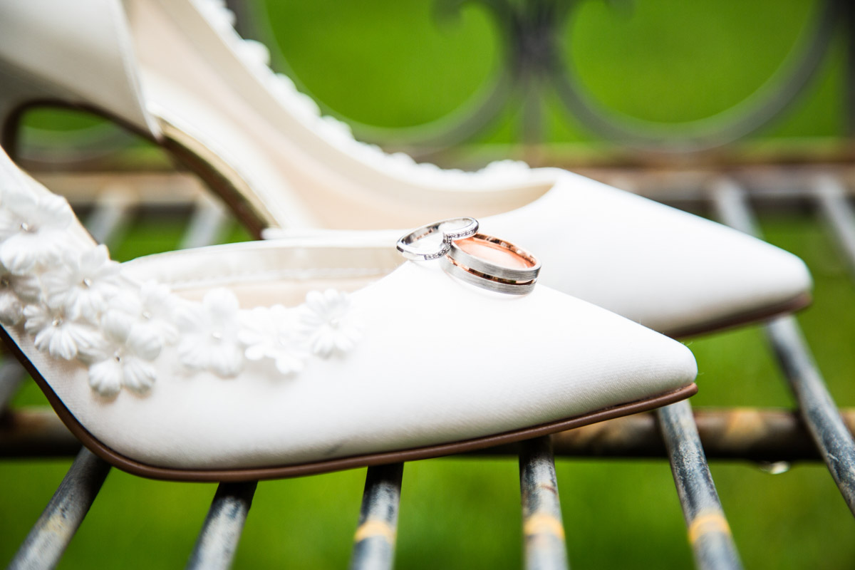 The wedding rings placed on the brides wedding shoes.