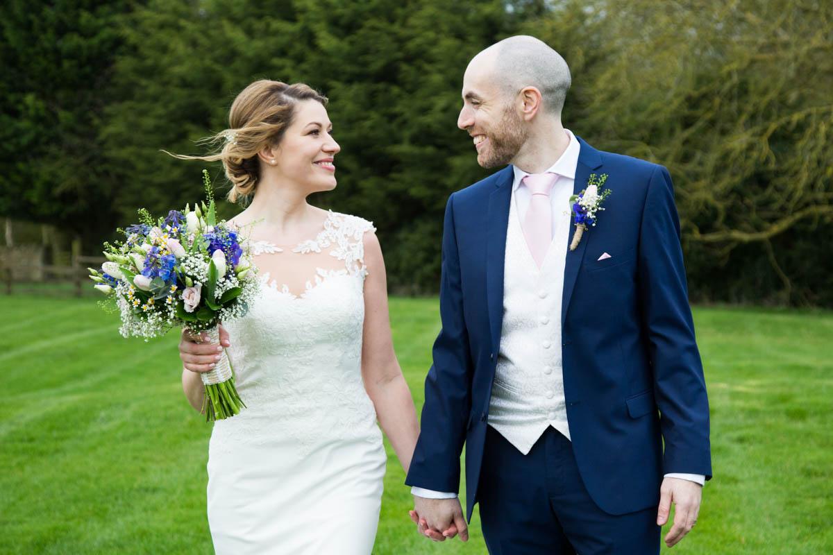 Bride and groom in Notley Tythe Barn garden