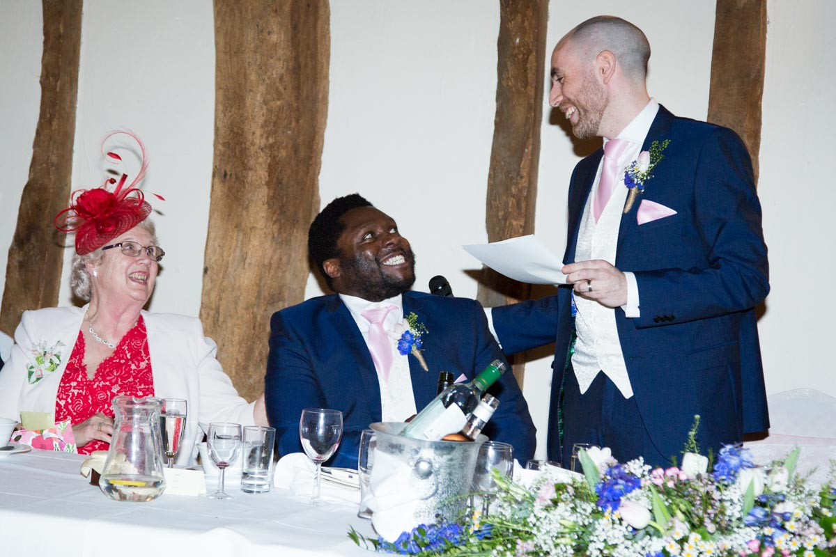 The groom looking at the best man whilst giving his wedding speech.