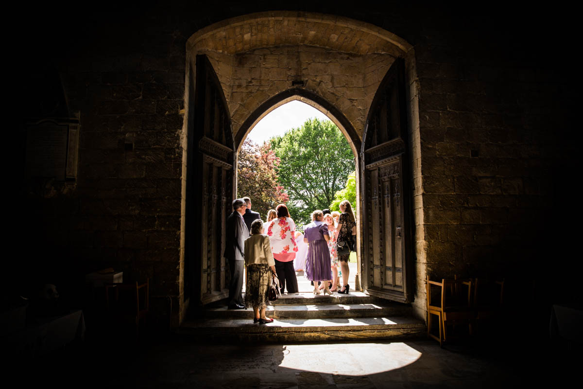 Wedding guests walking out of the Tewkesbury Abbey