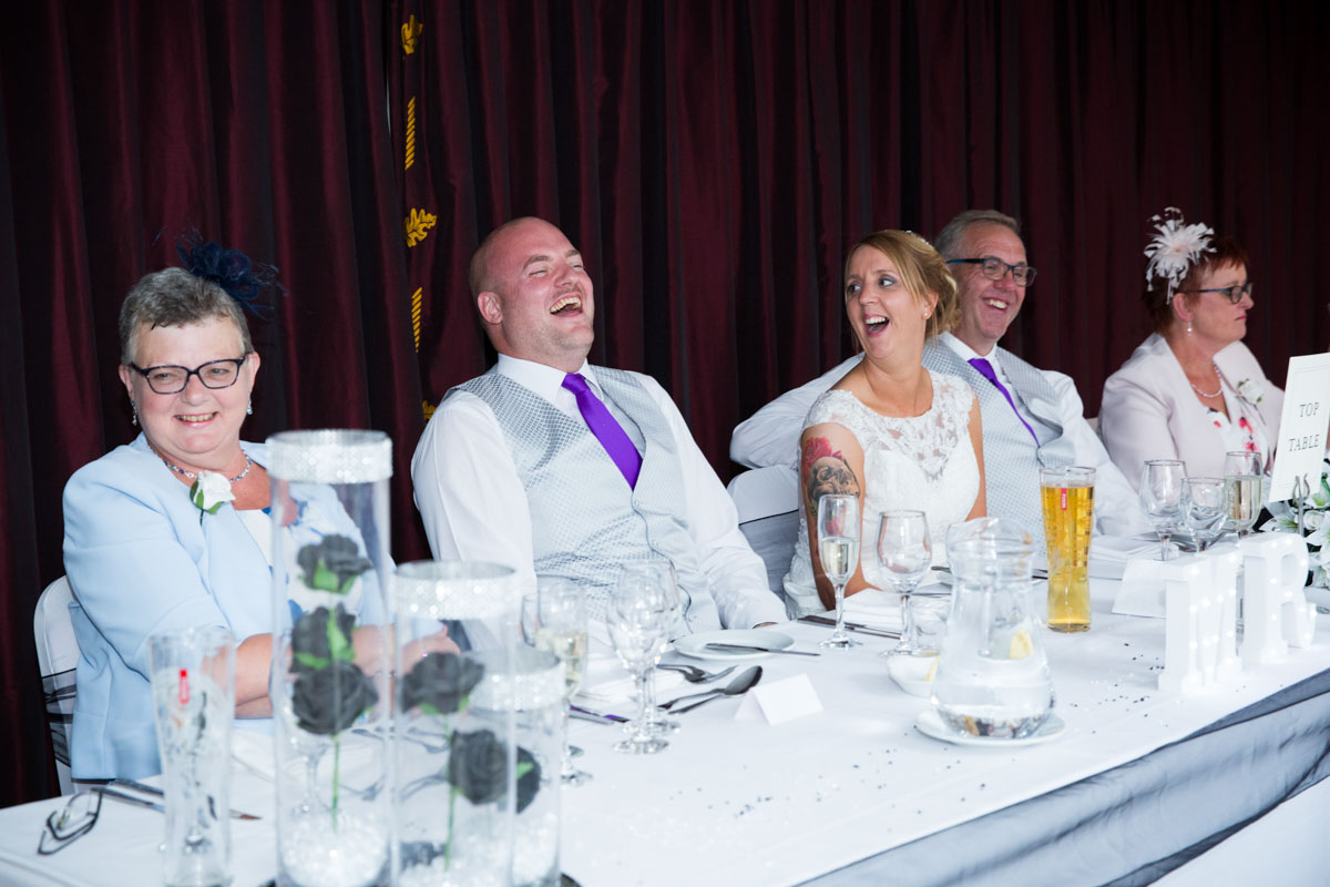 Bride and grooms reaction to Best Mans speech at the Cheltenham Regency Hotel wedding.