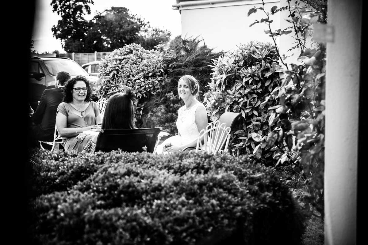 Bride and friends sat in the garden of the Cheltenham Regency Hotel.