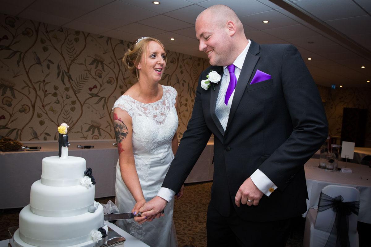 Bride and groom cutting the cake. Cheltenham Regency Hotel wedding.