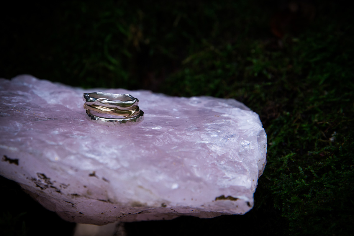 Handmade twig rings by Wild by Descent, sat on crystal in a tree.