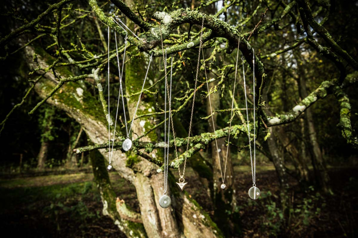 Necklaces hanging in a tree for jewellery commercial photography shoot. Glasgow photographer. Wild by Descent.