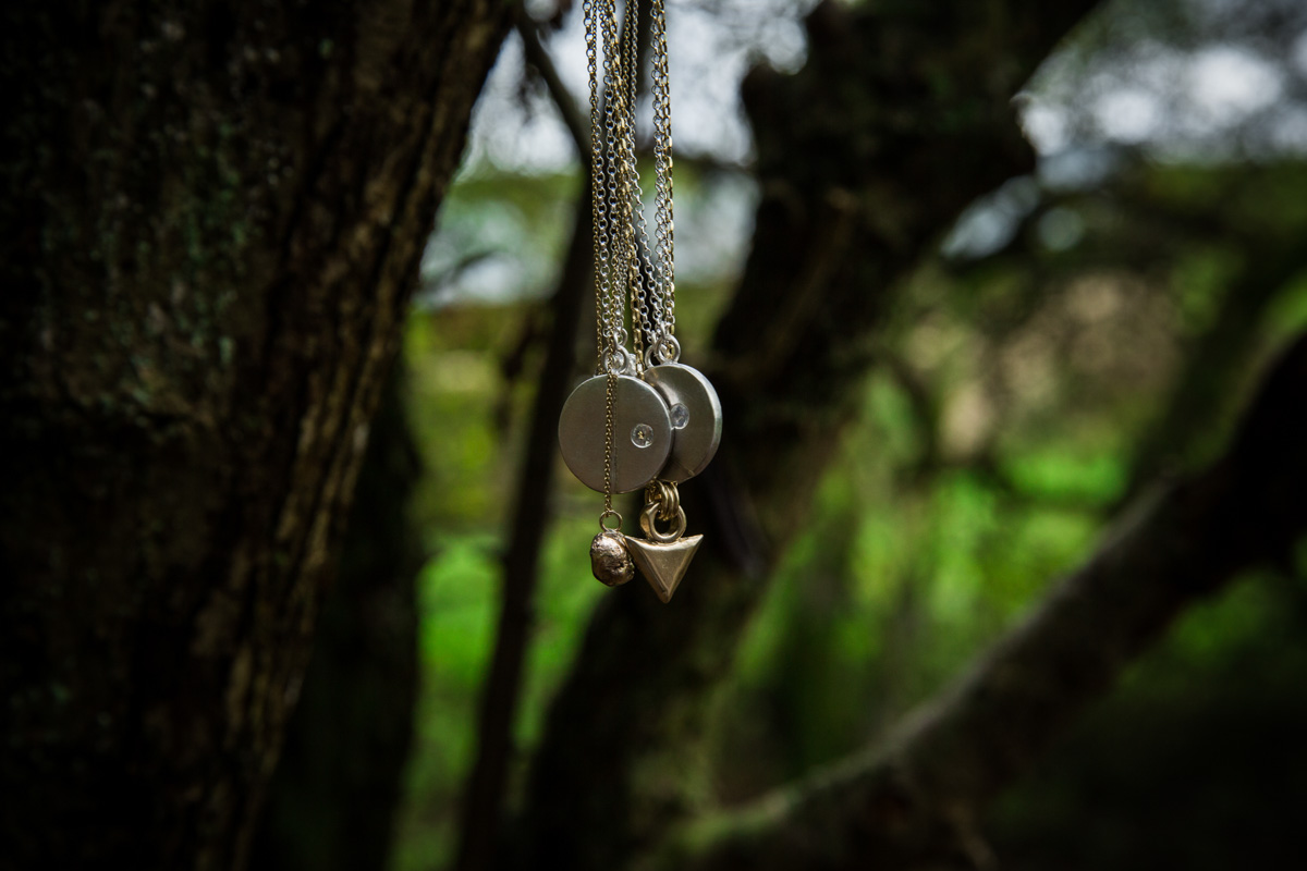 Necklaces hanging in a tree for jewellery commercial photo shoot. Glasgow photographer.