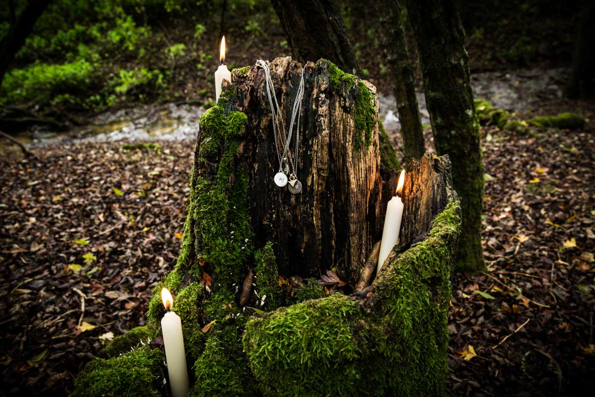Necklaces and candles in a hollowed out tree. Commercial photographer Glasgow. Canon 5D mkiii 24-70mm.