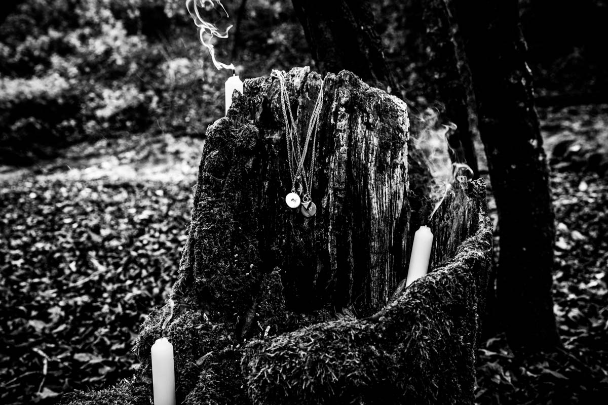 Necklaces and candles in a hollowed out tree. Scotland commercial photographer. Canon 5D mkiii 24-70mm.