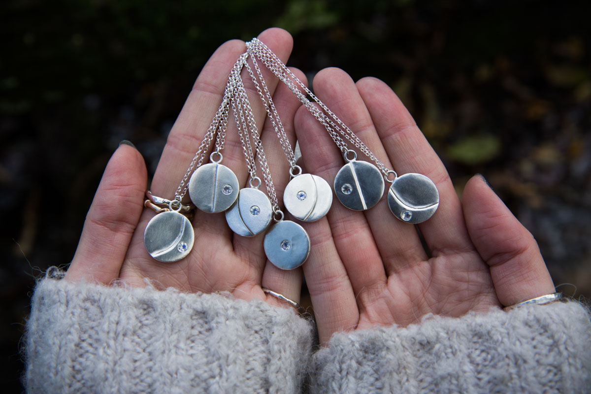 Jewellery commercial photography. Silver necklaces in hands