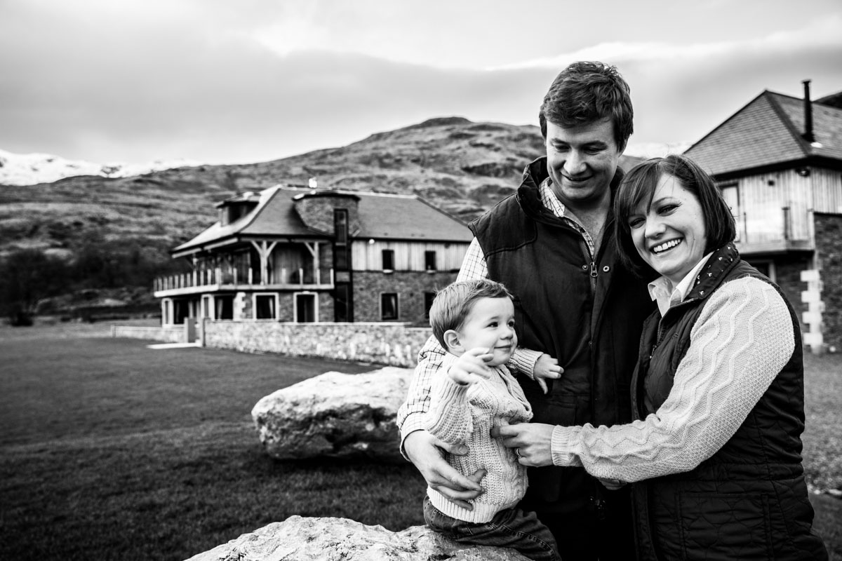 A young family stood in the gardens of Carrick Castle Estate. Glasgow wedding photographer