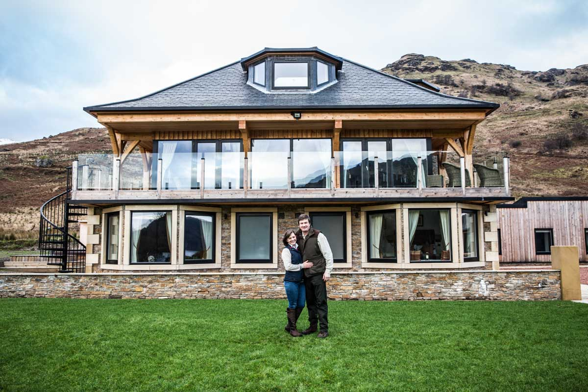 Hannah Mellet stood in front of Carrick Castle Lodge with her husband.