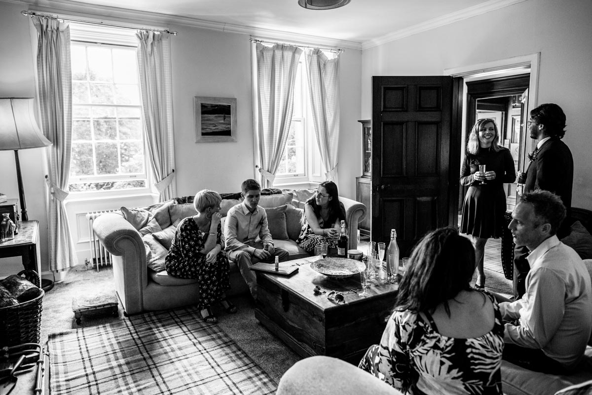 Wedding guests relaxing at Old Kilmun house wedding.