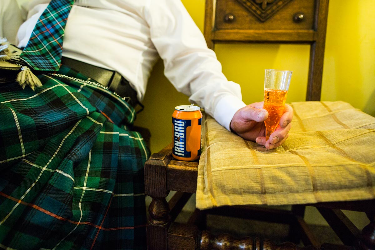 Iron Bru and a kilt at wedding reception. Glasgow wedding photographer