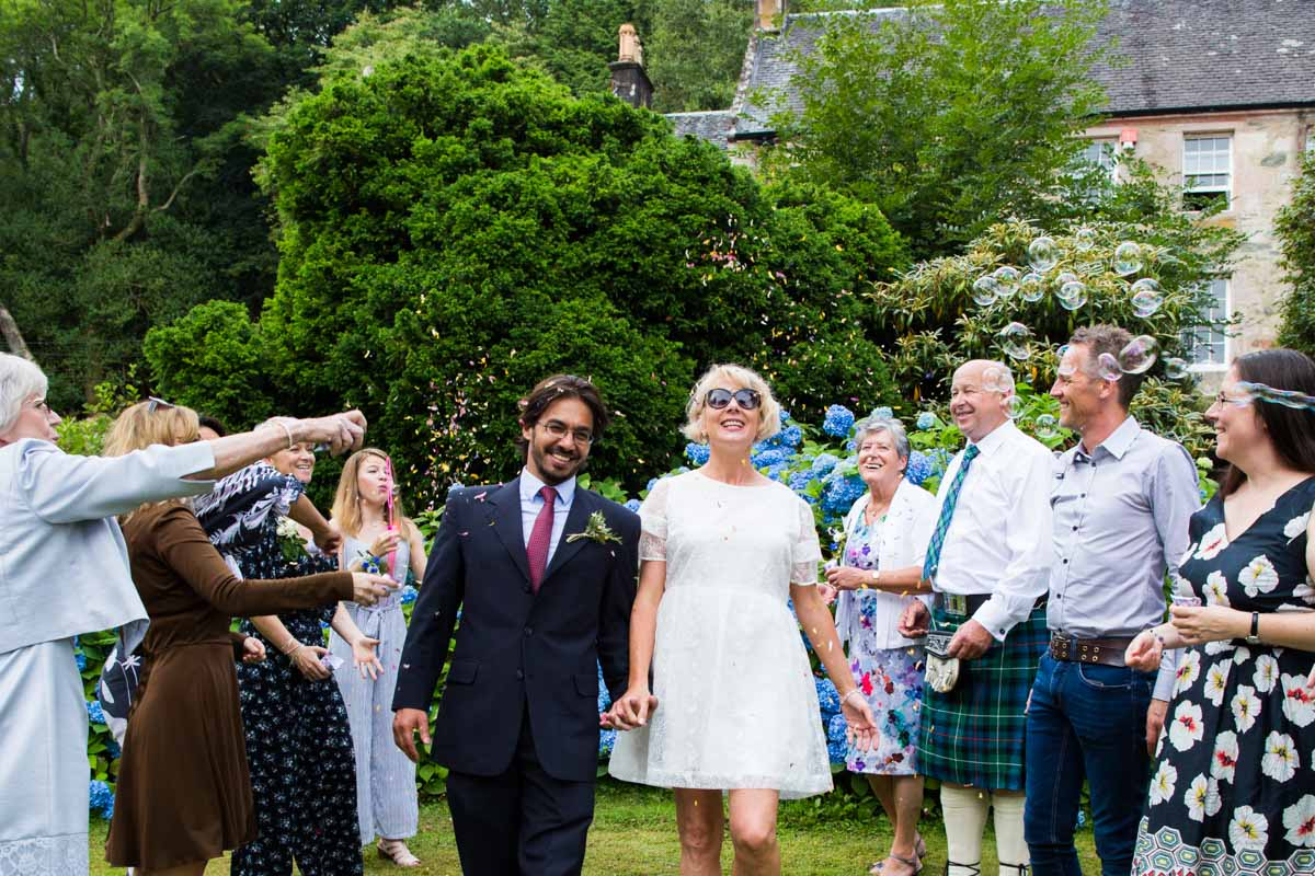 Bride and groom confetti line at Old Kilmun House wedding. Glasgow wedding photographer. Dunoon wedding photography.