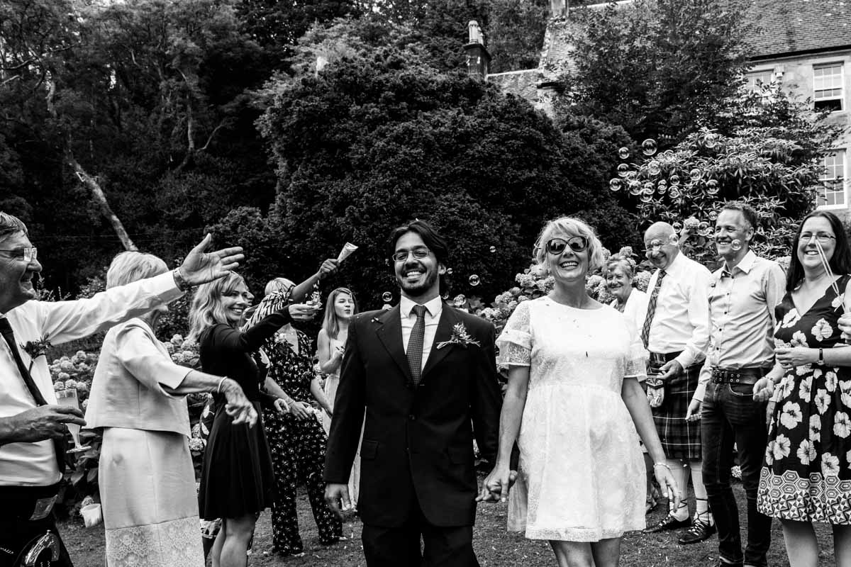 Bride and groom confetti line at Old Kilmun House wedding. Edinburgh wedding photographer. Dunoon wedding photography.