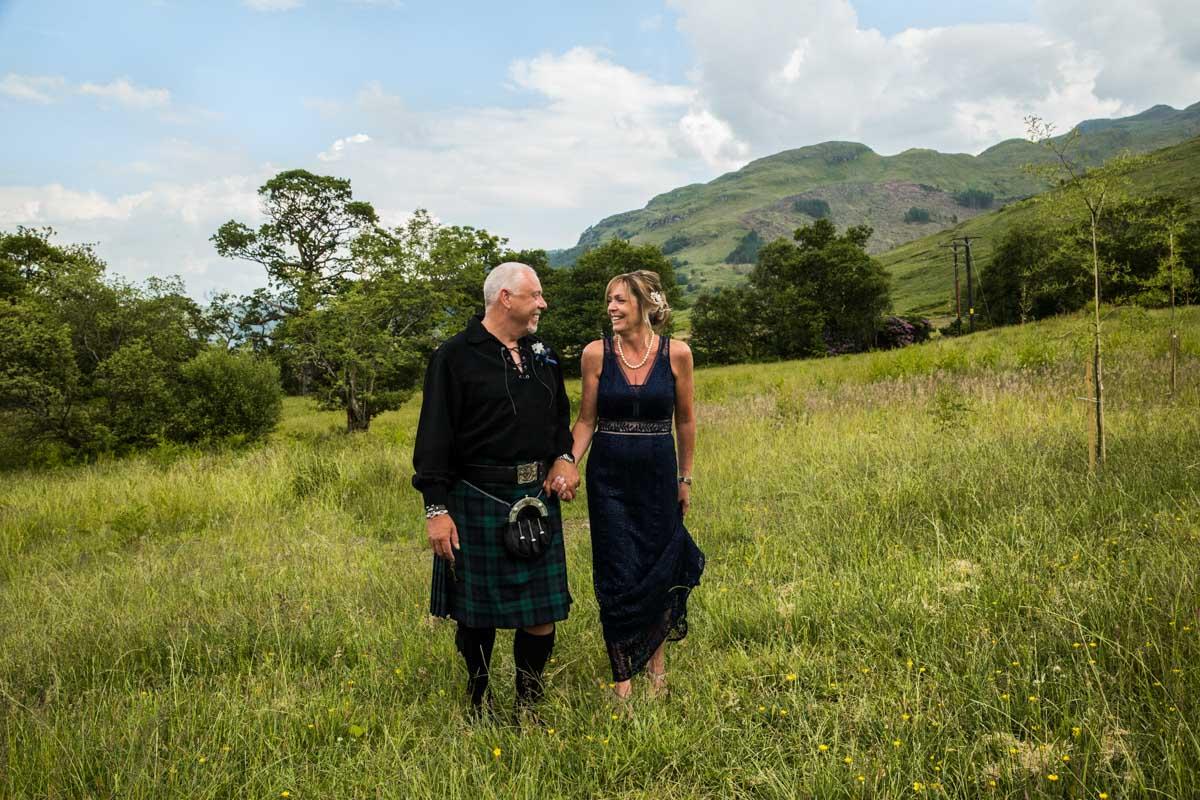 Bride and groom at Carrick Castle Estate wedding. Scotland destination wedding photographer. Lodge on Loch goil wedding