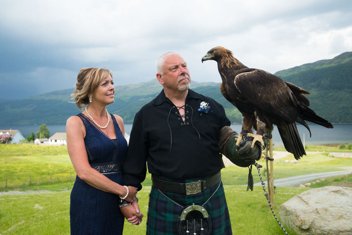 Scotland wedding photographer, golden eagle with bride and groom at Carrick Castle wedding